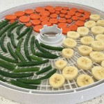 Banana, carrots & string beans on tray.